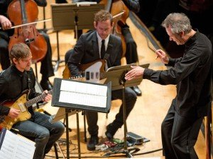 Brothers Aaron and Bryce Dessner performing with the CSO in 2014 under the baton of Louis Langree.