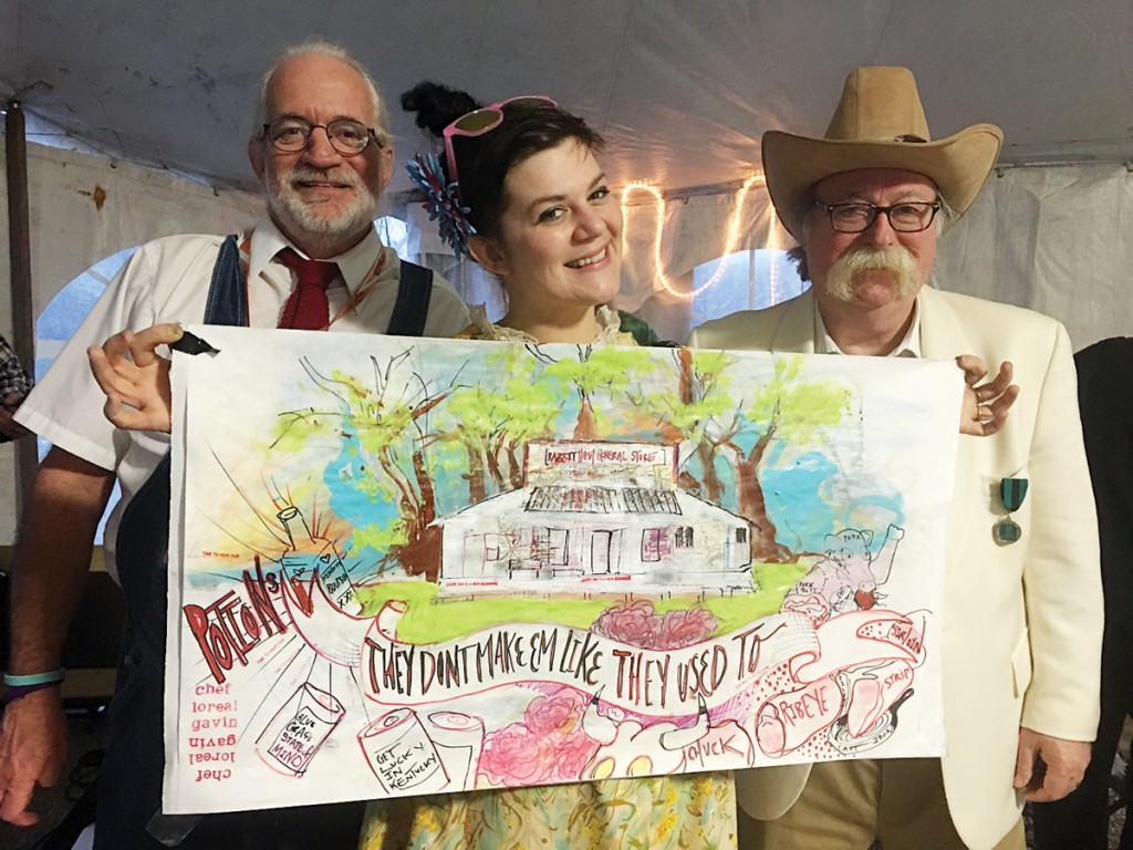 Don Clare, president of the Rabbit Hash Historical Society; Food Network star chef Loreal Gavin; and Colonel De of Colonel De Herbs & Spices with Gavin's art of the Rabbit Hash General Store