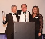 Honoree Patrick Hughes with Rick Hulefeld and Shannon Starkey Taylor