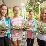 Lily Lippert, Happy Quinn, Holland Lippert and DeHaven Quinn with the fairy gardens they made.