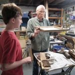 Grandfather/grandson team of Bob and Jack Sherwood at work on their project