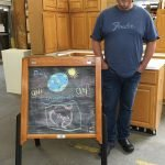 Chris Laux and his chalkboard