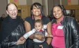Judy Van Ginkel, president of Every Child Succeeds, with ECS mom Sierra and her son, ECS coach Jasma Warner