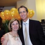 Tammy Weidinger, president and CEO of Brighton Center, with Cris Collinsworth