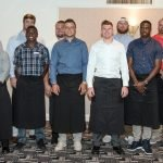 Bengals quarterback Andy Dalton (front, fifth from left) with teammates who served as celebrity waiters