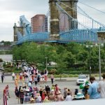 Stilt walkers greet guests parading through Smale Riverfront Park. Credit: Lisa Hubbard