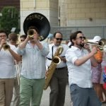 The Cincy Brass leads a festive stroll through Smale Riverfront Park