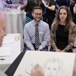 Elizabeth Leugers and Griffin Bates pose for the caricaturist.