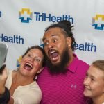 Fans taking a selfie with Rey Maualuga