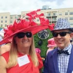Sherie Marek in hat from a Women's Alliance luncheon, with Jay Springer, whose hat matches his shirt