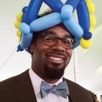 Dhani Jones, in one of the balloon hats provided for those who showed up bareheaded
