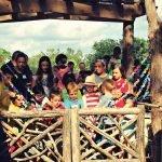 Children pile onto NaturePlay@BCM's cruise line swing.
