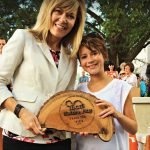 Carri Chandler, Toyota External Affairs, and her daughter Darah, 10, display the custom-made NaturePlay sponsor plaque presented to Toyota.