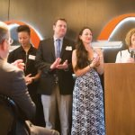 Pam Paley of US Bank (speaking), head of the selection committee, with Lynn Love, Brandon Swinehart and Sara Swinehart