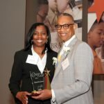 Emcee Clyde Gray and honoree Demetra Jones