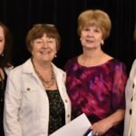 Jackie Lang, MWC president; Ann Daumeyer, recording secretary; Joyce Yock, fashion show chair; and Diana Davis