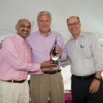 Ali Hussain, U.S. Bank vice president, and Michael Prescott, U.S. Bank president, accept the presenting sponsor award from event co-chair Don Keller.