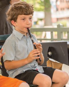 Louis playing the pennywhistle, a student at the Riley School of Irish Music
