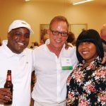 Community Shares board member Matt Murray with Shauntia Edwards and Jermaine Bryant, winning amateur chefs representing Shelterhouse