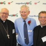 Bishop Joseph Binzer, Roger Grein, founder of Magnified Giving, and Father Chris Coleman, a Magnified Giving board member