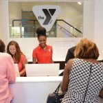 Central Parkway YMCA Welcome Center staff members greet guests.