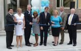 Central Parkway YMCA executive director (and YMCA Group Vice President) Bill Powell at the ribbon-cutting ceremony. At left is Elizabeth Frazier (Central Parkway YMCA health and wellness director), Jesiah Brock (Central Parkway associate director) and Sandy Walker (president and CEO, YMCA of Greater Cincinnati)