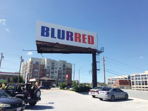 Kay Rosen, BLURRED, 2004/2014. Installed on I-71 East in Cincinnati, Smith Road exit. Photograph by Anne Thompson