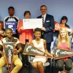 CYC President and CEO Jane Keller and AT&T's director of external affairs Mark Romito, with Outstanding Student Award nominees: (back) Mariejane Tuyizere, Niaj Bell, Christie Uetrecht and Hayley Suiter; (front) Gift Mayambi, Charlotte Niyonkuru and Staci Stephens