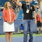 Pam Green, Easter Seals president and CEO, joins Kris Paronto for a coin toss.