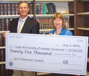 GE's Bradley Mottier with Legal Aid executive director Mary Asbury