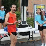 Brian Korday, top overall runner, with race co-chair McKenna Johnson