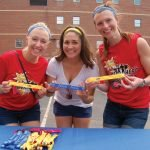 Maggie M. Nestheide with Kellie Kulka and Sarah Sanderson, YLS volunteers and Superhero Run committee members