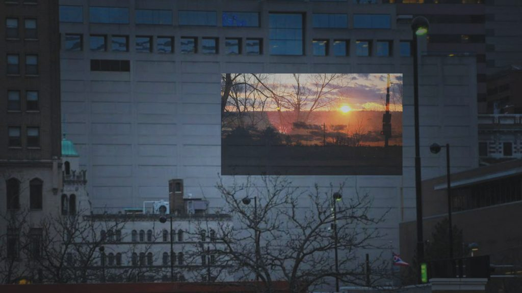 """A mock-up of C. Jacqueline Wood's projection, """"SHINE,"""" on display after dark during October at the Cincinnati Main Public Library"""