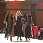 Models show coats.