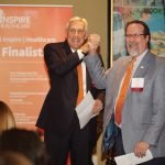 Rob Reifsnyder, United Way, and Neil Tilow of Talbert House