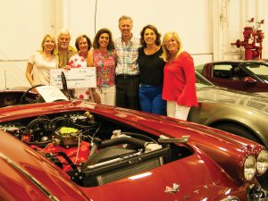 Petra and Russ Vester, (center) winners of a 1961 Corvette convertible with Megan Joy, John Richardson, Julie Richardon, and (to the right of the Vesters) Susan Mustian and Kate Devine.