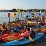 Safety paddlers keep check on swimmers.