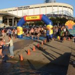 Swimmers get a hand at the finish line.