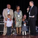 Emcee Mike Dardis of WLWT with A Kid Again family, the Tudors
