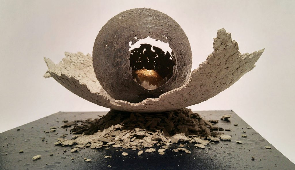 "PJ Grimm, ""Egg Formation 1,"" Campbell County Recorder series ""Golden Age"", 2016, paper pulp (made from the Campbell County Recorder), cement, acrylic & gold leaf on wooden base"