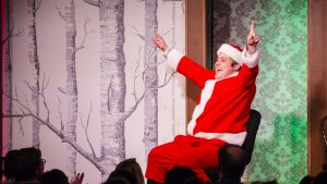 Charles Pettitt in the Cincinnati Playhouse in the Park's production of The Second City's Holidazed & Confused Revue.