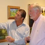 freshARTist Adam Wisler and Jack Gore study the completed artwork before the auction.