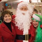 CPS Superintendent Mary Ronan, a Rotarian, with Santa and his helper