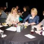 Women's Leadership Roundtable members participate in the Drink and Draw activity.