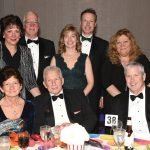 Phillips Supply Co. table: (seated) Pam Rossmann, Courtney Rossmann, Chris Conners; (standing) Kathy Mitts, Bob Mitts, Karin Kruse, Jeff Kruse, Angie Conners