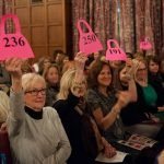 Bidders raise their paddles during the 2016 live auction.