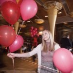 Volunteer Kristen Sellan passes out balloons.