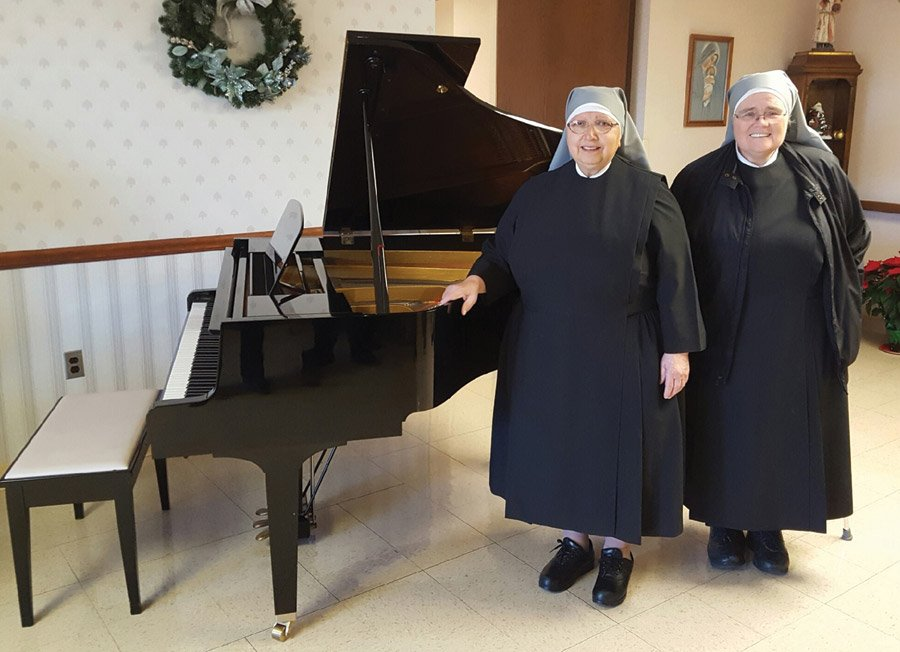 Sisters Imelda and Katharine Ann, with the piano