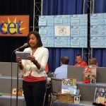 Volunteer Marla Fuller sells a board during the 2016 CET Action Auction.