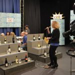 Laure Quinlivan helps auction wine during wine night, which will be Saturday again this year.